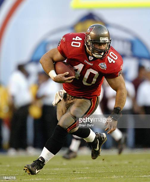 Mike Alstott of the Tampa Bay Buccaneers runs with the ball against the Oakland Raiders during Super Bowl XXXVII on January 26 2003 at Qualcomm...