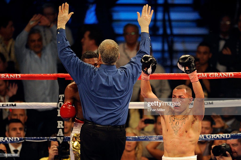 Mike Alvarado celebrates as referee Jay Nady calls the fight as Alvarado wins by a 10th round TKO against Breidis Prescott in their junior...
