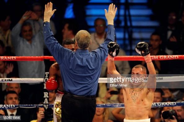 Mike Alvarado celebrates as referee Jay Nady calls the fight as Alvarado wins by a 10th round TKO against Breidis Prescott in their junior...