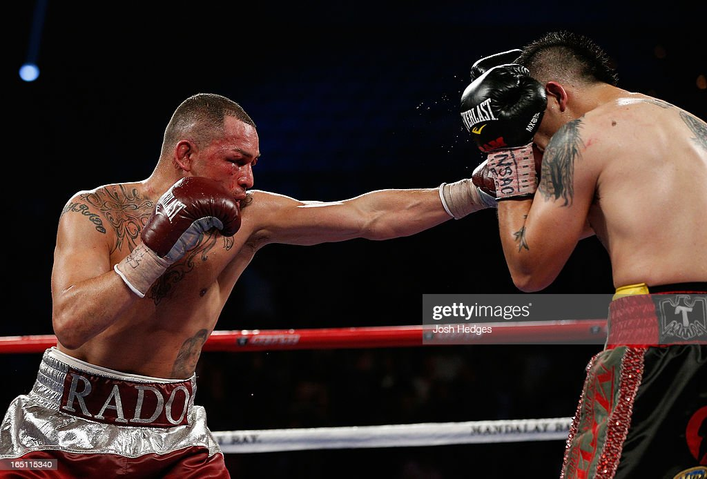 Mike Alvarado lands a left to the head of Brandon Rios in their WBO interim junior welterweight championship bout at the Mandalay Bay Events Center on March 30, 2013 in Las Vegas, Nevada.