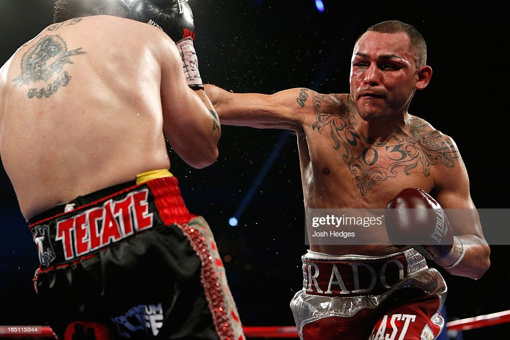 Mike Alvarado lands a right to the head of Brandon Rios in their WBO interim junior welterweight championship bout at the Mandalay Bay Events Center on March 30, 2013 in Las Vegas, Nevada.