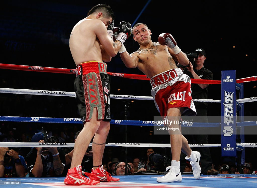 Mike Alvarado lands a right uppercut to the head of Brandon Rios in their WBO interim junior welterweight championship bout at the Mandalay Bay Events Center on March 30, 2013 in Las Vegas, Nevada.