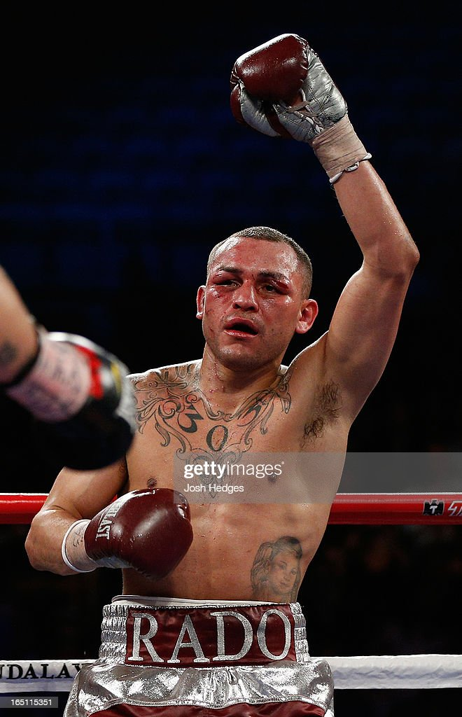 Mike Alvarado raises his hand in victory after the conclusion of the twelfth round of his WBO interim junior welterweight championship bout against Brandon Rios at the Mandalay Bay Events Center on March 30, 2013 in Las Vegas, Nevada.