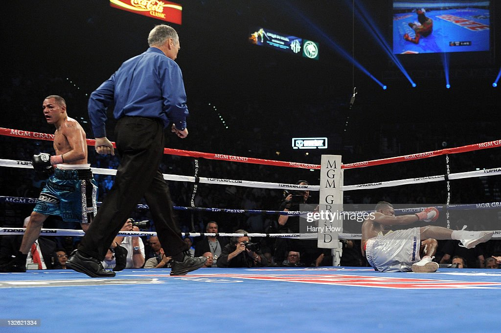 Mike Alvarado runs to his corner after knocking down Breidis Prescott in the 10th round in their junior welterweight fight at the MGM Grand Garden...
