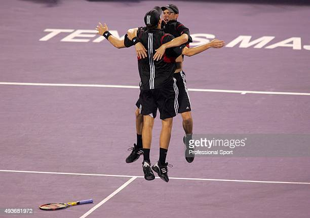 Mike and Bob Bryan celebrate a point against Wayne Black and Kevin Ulyett of Zimbabwe during double's final at the Tennis Masters Cup November 20...