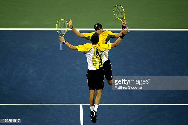 Mike and Bob Bryan celebrate match point against Colin Fleming and Jonathan Marray of Great Britain on Day Eight of the 2013 US Open at USTA Billie...