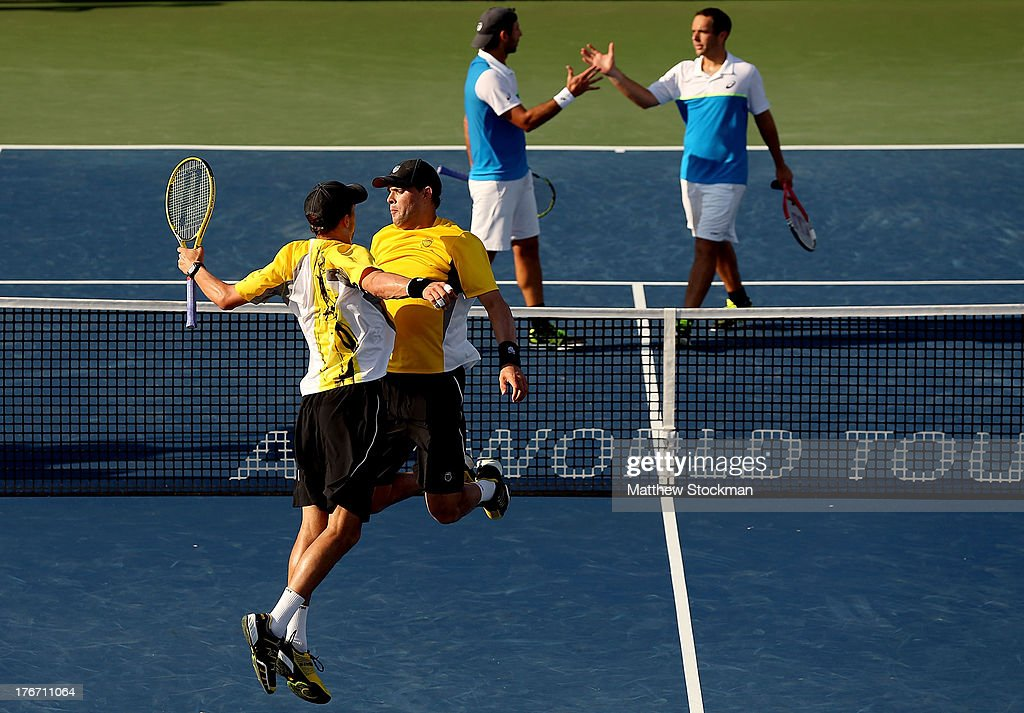 Mike and <a gi-track='captionPersonalityLinkClicked' href=/galleries/search?phrase=Bob+Bryan+-+Tennis+Player&family=editorial&specificpeople=203335 ng-click='$event.stopPropagation()'>Bob Bryan</a> celebrate match point against Santiago Gonzalez of Mexico and Scott Lipsky during the semifinals of the Western & Southern Open on August 17, 2013 at Lindner Family Tennis Center in Cincinnati, Ohio.