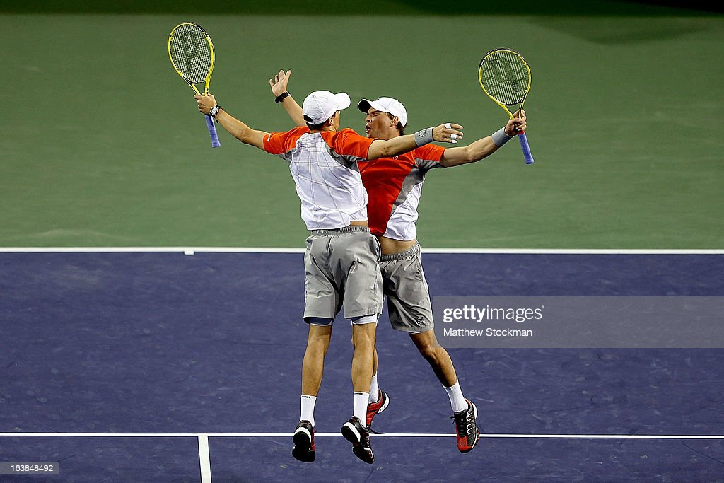 Mike and <a gi-track='captionPersonalityLinkClicked' href=/galleries/search?phrase=Bob+Bryan+-+Tennis+Player&family=editorial&specificpeople=203335 ng-click='$event.stopPropagation()'>Bob Bryan</a> celebrate match point against Treat Huey of the Philippines and Jerzy Janowicz of Poland during the doubles final of the BNP Paribas Open at the Indian Wells Tennis Garden on March 16, 2013 in Indian Wells, California.