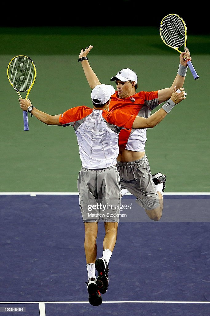 Mike and Bob Bryan celebrate match point against Treat Huey of the Philippines and Jerzy Janowicz of Poland during the doubles final of the BNP Paribas Open at the Indian Wells Tennis Garden on March 16, 2013 in Indian Wells, California.