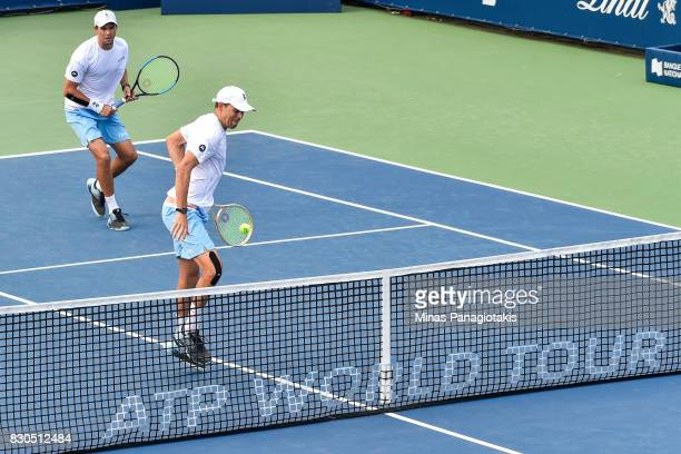 Mike and Bob Bryan of the United States compete in their doubles match against PierreHugues Herbert and teammate Nicolas Mahut of France during day...