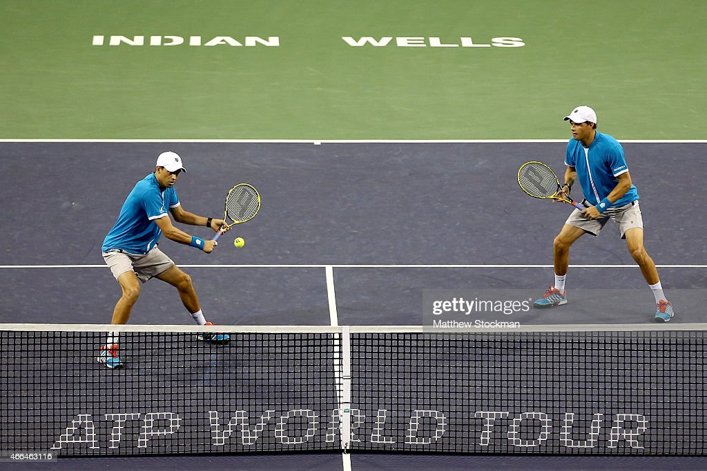 Mike and Bob Bryan play Kevin Anderson of South Africa and Jurgen Melzer of Austria during day seven of the BNP Paribas Open at the Indian Wells Tennis Garden on March 15, 2015 in Indian Wells, California.