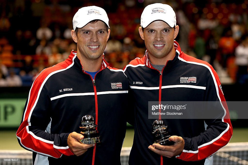 Mike and <a gi-track='captionPersonalityLinkClicked' href=/galleries/search?phrase=Bob+Bryan+-+Tennis+Player&family=editorial&specificpeople=203335 ng-click='$event.stopPropagation()'>Bob Bryan</a> pose for photographers after being presented the Davis Cup Commitment Award during the Davis Cup tie between the United States and Serbia at Taco Bell Arena on April 7, 2013 in Boise, Idaho.