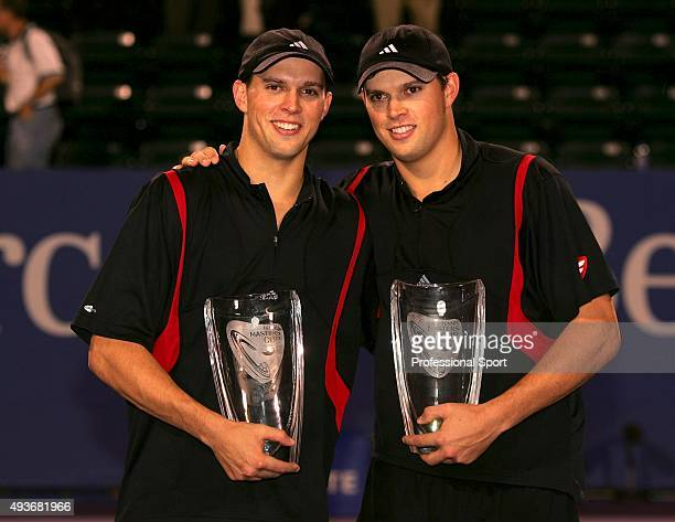 Mike and Bob Bryan pose with their trophies after winning the doubles final over Wayne Black and Kevin Ulyett of Zimbabwe and win the double's final...