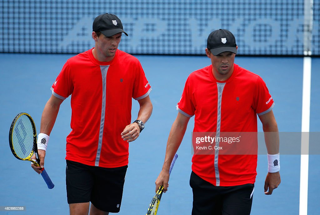 Mike and Bob Bryan react in their match against Christopher Eubanks and Donald Young during the BB&T Atlanta Open at Atlantic Station on August 1, 2015 in Atlanta, Georgia.