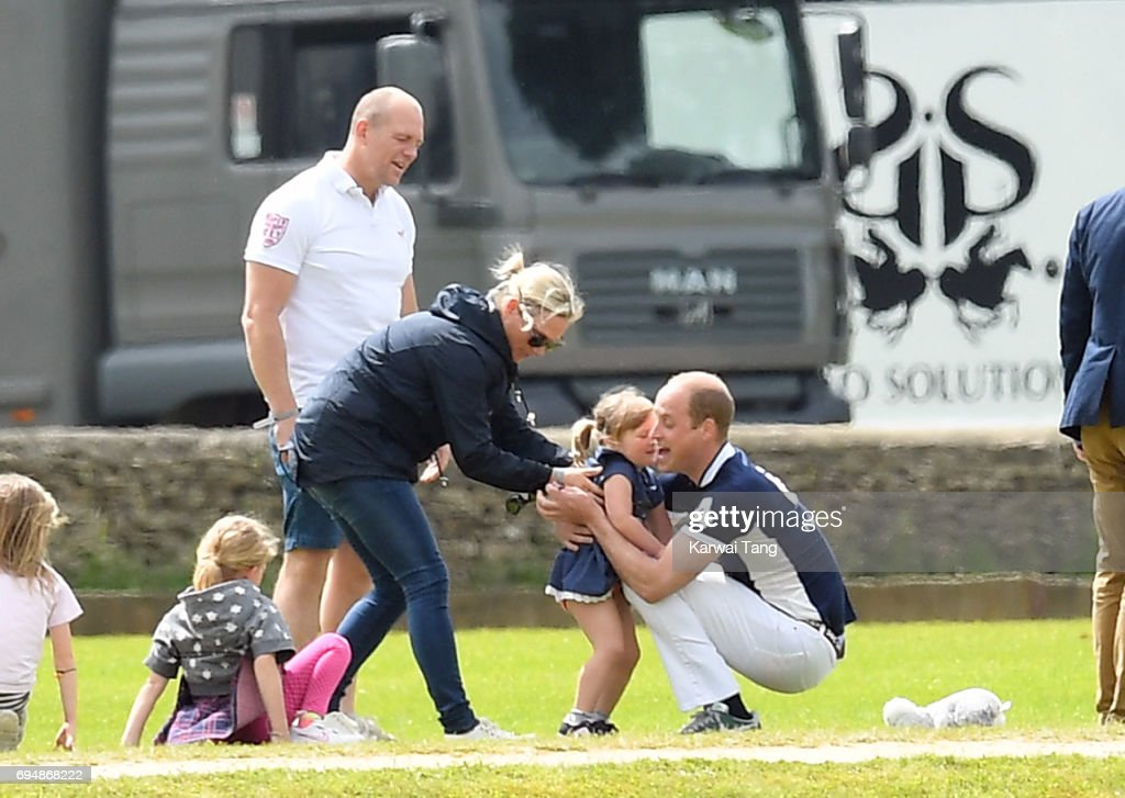 Mike and Zara Tindall watches daughter Mia get a hug from Prince William, Duke of Cambridge at the Maserati Royal Charity Polo Trophy at Beaufort Polo Club on June 11, 2017 in Tetbury, England.