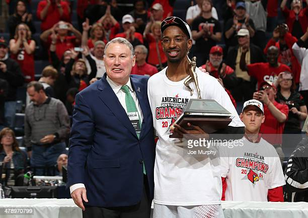 Mike Aresco Commisioner of the AAC poses with Russ Smith of the Louisville Cardinals and the tournament MVP trophy after defeating the Connecticut...