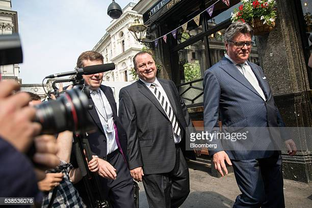 Mike Ashley billionaire founder of Sports Direct International Plc second right arrives to give evidence at a Business Innovation and Skills...