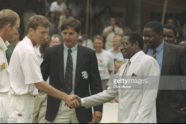 Mike Atherton the Captain of England meets Robert Mugabe the President of Zimbabwe before the start of the second test match between Zimbabwe and...