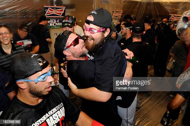 Mike Aviles Jason Giambi and Chris Perez of the Cleveland Indians celebrate with champagne after a win of the game against the Minnesota Twins on...