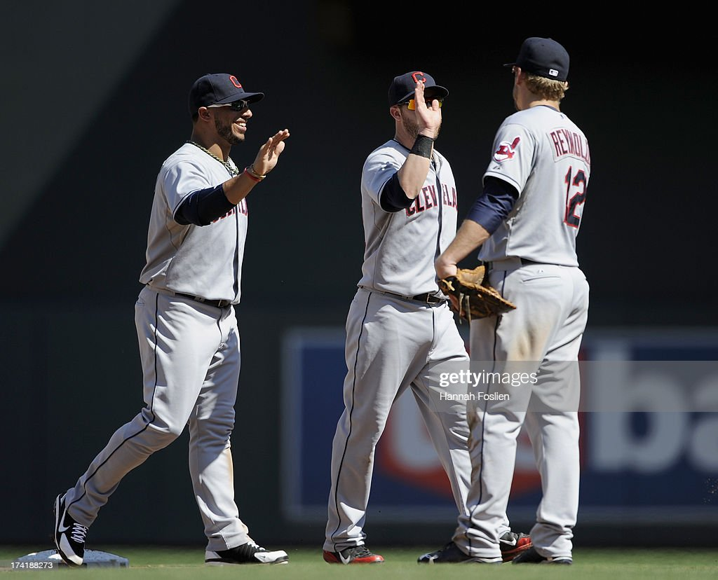 Mike Aviles #4, Jason Kipnis #22 and Mark Reynolds #12 of the Cleveland Indians celebrate a win of the game against the Minnesota Twins on July 21, 2013 at Target Field in Minneapolis, Minnesota. The Indians defeated the Twins 7-1.