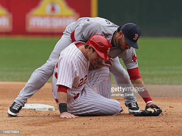 Mike Aviles of the Boston Red Sox falls over Brent Morel of the Chicago White Sox after turning a double play at US Cellular Field on April 29 2012...