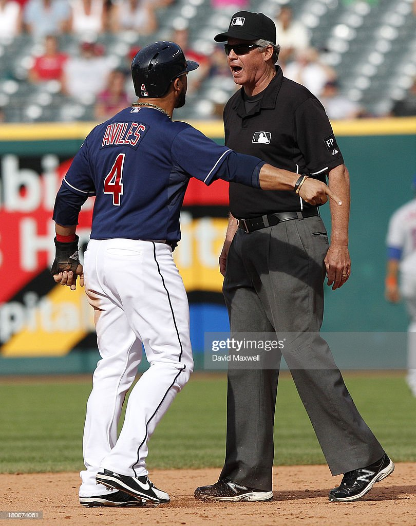 <a gi-track='captionPersonalityLinkClicked' href=/galleries/search?phrase=Mike+Aviles&family=editorial&specificpeople=4944765 ng-click='$event.stopPropagation()'>Mike Aviles</a> #4 of the Cleveland Indians argues with second base umpire Gary Darling after he was called out stealing against the New York Mets during the ninth inning of their game on September 8, 2013 at Progressive Field in Cleveland, Ohio. The Mets defeated the Indians 2-1.