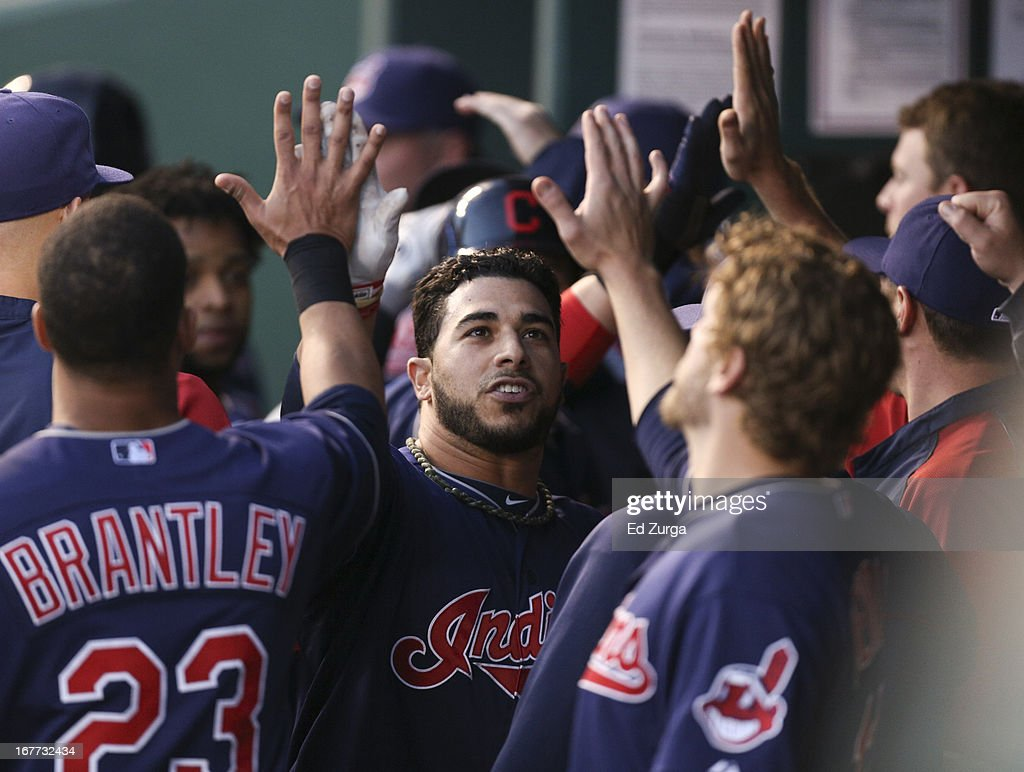 <a gi-track='captionPersonalityLinkClicked' href=/galleries/search?phrase=Mike+Aviles&family=editorial&specificpeople=4944765 ng-click='$event.stopPropagation()'>Mike Aviles</a> #4 of the Cleveland Indians celebrates his three-run home run with teammates in the third inning during game two of a doubleheader against the Kansas City Royals at Kauffman Stadium on April 28, 2013 in Kansas City, Missouri.
