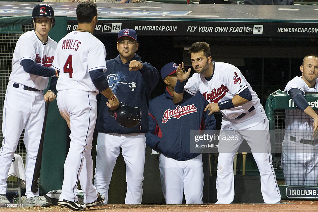 <a gi-track='captionPersonalityLinkClicked' href=/galleries/search?phrase=Mike+Aviles&family=editorial&specificpeople=4944765 ng-click='$event.stopPropagation()'>Mike Aviles</a> #4 of the Cleveland Indians celebrates with manager <a gi-track='captionPersonalityLinkClicked' href=/galleries/search?phrase=Terry+Francona&family=editorial&specificpeople=171936 ng-click='$event.stopPropagation()'>Terry Francona</a> #17 and <a gi-track='captionPersonalityLinkClicked' href=/galleries/search?phrase=Nick+Swisher&family=editorial&specificpeople=206417 ng-click='$event.stopPropagation()'>Nick Swisher</a> #33 after scoring in the fifth inning against the Boston Red Sox at Progressive Field on April 18, 2013 in Cleveland, Ohio.