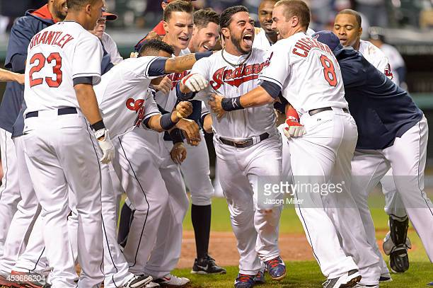 Mike Aviles of the Cleveland Indians celebrates with teammates after hitting a walkoff solo home run during the eleventh inning against the Baltimore...