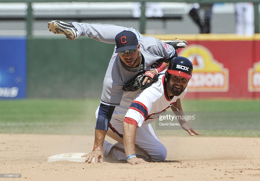 <a gi-track='captionPersonalityLinkClicked' href=/galleries/search?phrase=Mike+Aviles&family=editorial&specificpeople=4944765 ng-click='$event.stopPropagation()'>Mike Aviles</a> #4 of the Cleveland Indians forces out <a gi-track='captionPersonalityLinkClicked' href=/galleries/search?phrase=Jordan+Danks&family=editorial&specificpeople=2364706 ng-click='$event.stopPropagation()'>Jordan Danks</a> #20 of the Chicago White Sox during the sixth inning on June 30, 2013 at U.S. Cellular Field in Chicago, Illinois.