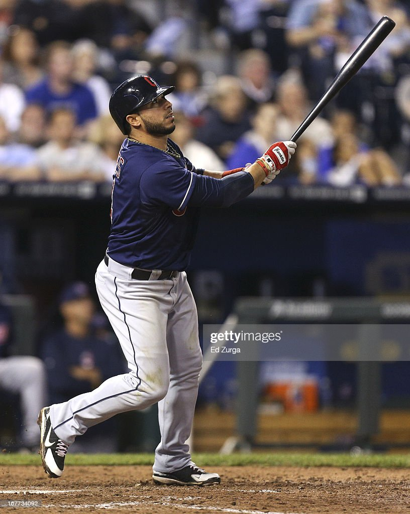 <a gi-track='captionPersonalityLinkClicked' href=/galleries/search?phrase=Mike+Aviles&family=editorial&specificpeople=4944765 ng-click='$event.stopPropagation()'>Mike Aviles</a> #4 of the Cleveland Indians hits a sacrifice fly in the seventh inning against the Kansas City Royals during game two of a doubleheader at Kauffman Stadium on April 28, 2013 in Kansas City, Missouri.