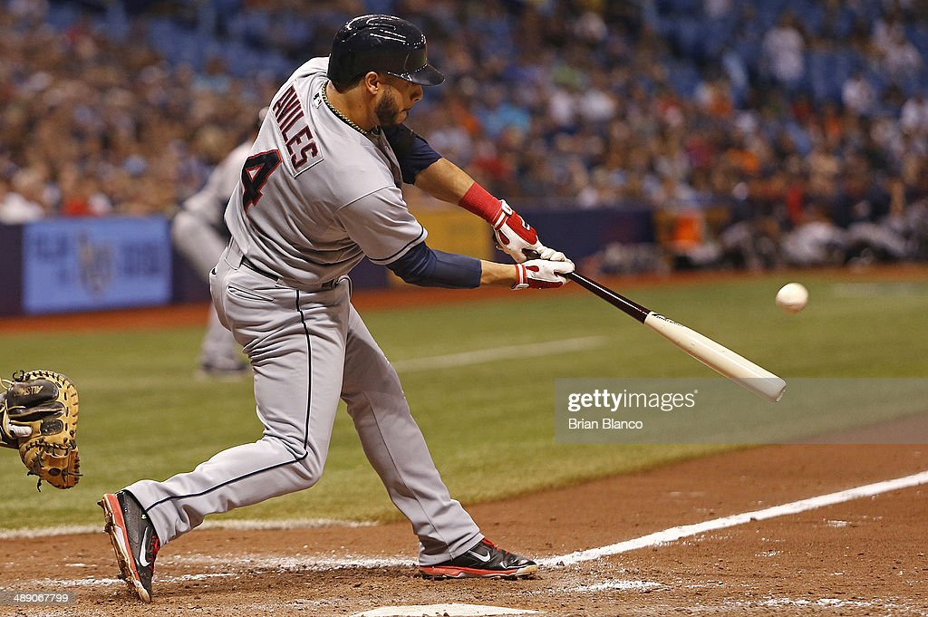 <a gi-track='captionPersonalityLinkClicked' href=/galleries/search?phrase=Mike+Aviles&family=editorial&specificpeople=4944765 ng-click='$event.stopPropagation()'>Mike Aviles</a> #4 of the Cleveland Indians hits a three-run home run during the seventh inning of a game against the Tampa Bay Rays on May 9, 2014 at Tropicana Field in St. Petersburg, Florida.