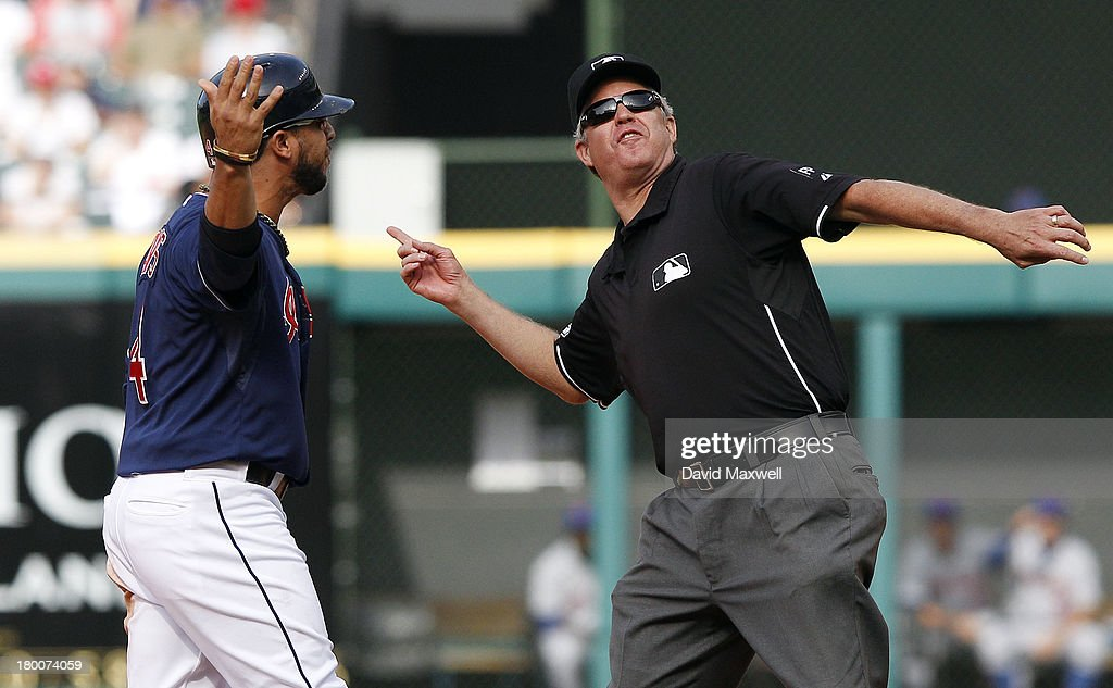 <a gi-track='captionPersonalityLinkClicked' href=/galleries/search?phrase=Mike+Aviles&family=editorial&specificpeople=4944765 ng-click='$event.stopPropagation()'>Mike Aviles</a> #4 of the Cleveland Indians is ejected from the game by second base umpire Gary Darling during an argument after he was called out stealing second base against the New York Mets during the ninth inning of their game on September 8, 2013 at Progressive Field in Cleveland, Ohio. The Mets defeated the Indians 2-1.