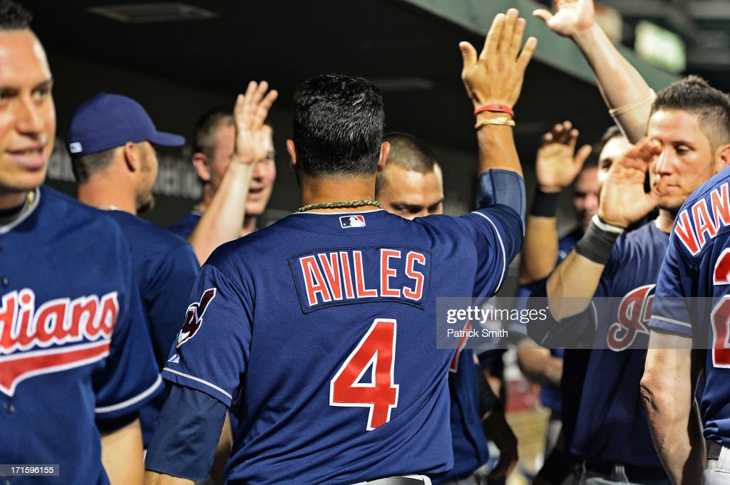 <a gi-track='captionPersonalityLinkClicked' href=/galleries/search?phrase=Mike+Aviles&family=editorial&specificpeople=4944765 ng-click='$event.stopPropagation()'>Mike Aviles</a> #4 of the Cleveland Indians is greeted in the dugout after scoring the ninth inning against the Baltimore Orioles at Oriole Park at Camden Yards on June 26, 2013 in Baltimore, Maryland. The Cleveland Indians won, 4-3.