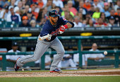 Mike Aviles of the Cleveland Indians lays down a bunt against the Detroit Tigers during game two of a doubleheader at Comerica Park on July 19 2014...