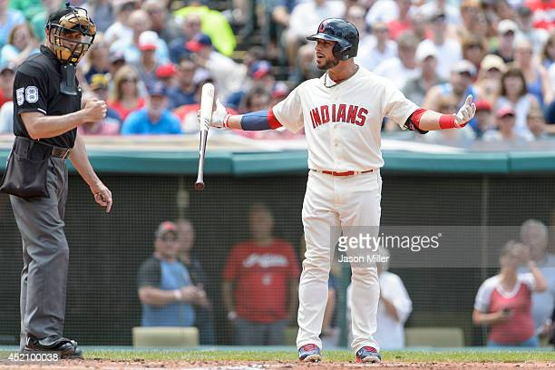 Mike Aviles of the Cleveland Indians reacts as home plate umpire Dan Iassogna calls him out on a check swing during the second inning against the...