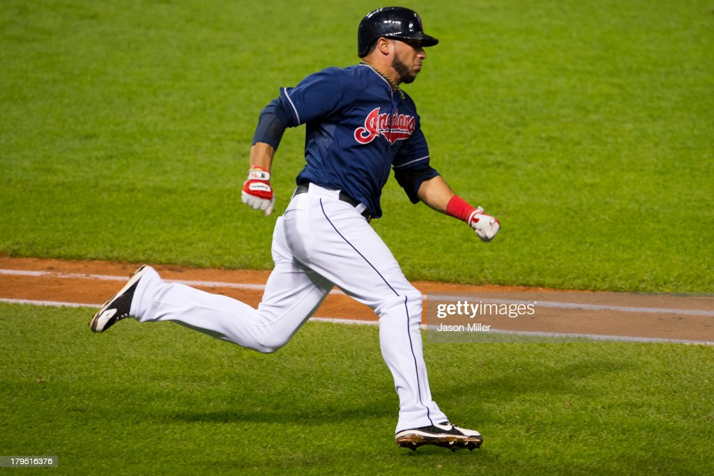 <a gi-track='captionPersonalityLinkClicked' href=/galleries/search?phrase=Mike+Aviles&family=editorial&specificpeople=4944765 ng-click='$event.stopPropagation()'>Mike Aviles</a> #4 of the Cleveland Indians rounds first base on his way to second on a shot to deep left during the fourth inning against the Baltimore Orioles at Progressive Field on September 4, 2013 in Cleveland, Ohio.