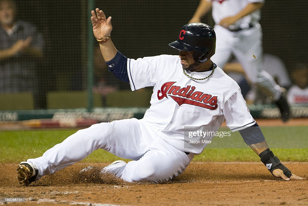 <a gi-track='captionPersonalityLinkClicked' href=/galleries/search?phrase=Mike+Aviles&family=editorial&specificpeople=4944765 ng-click='$event.stopPropagation()'>Mike Aviles</a> #4 of the Cleveland Indians scores on a single hit by Michael Brantley #23 during the sixth inning against the Detroit Tigers at Progressive Field on May 22, 2013 in Cleveland, Ohio.
