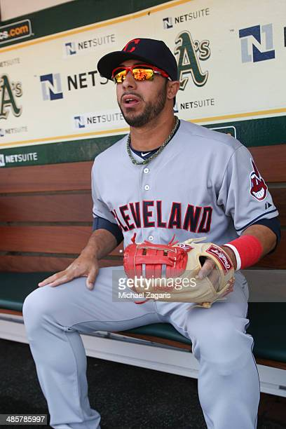 Mike Aviles of the Cleveland Indians sits in the dugout prior to the game against the Oakland Athletics at Oco Coliseum on April 2 2014 in Oakland...