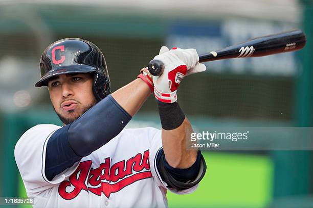 Mike Aviles of the Cleveland Indians warms up in the on deck circle during the first inning against the Minnesota Twins at Progressive Field on June...