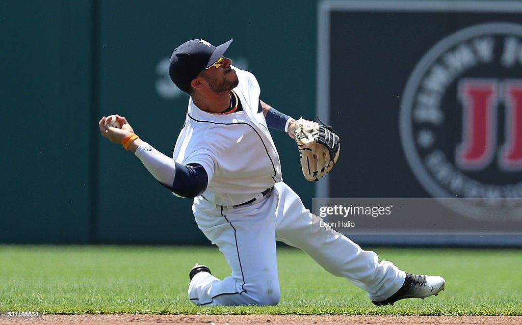 Mike Aviles #14 of the Detroit Tigers makes the throw to first base during the first inning of the inter-league game against the Philadelphia Phillies game on May 25, 2016 at Comerica Park in Detroit, Michigan.