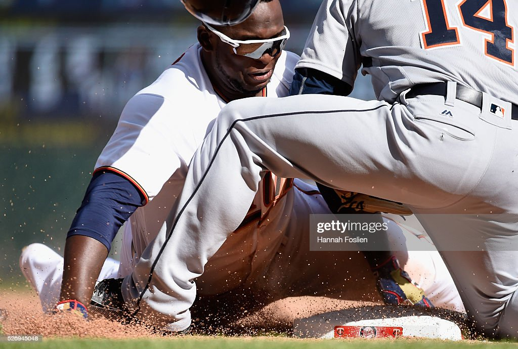 Mike Aviles #14 of the Detroit Tigers tags out Miguel Sano #22 of the Minnesota Twins at third base attempting to stretch a double into a triple to end the game in the ninth inning on May 1, 2016 at Target Field in Minneapolis, Minnesota. The Tigers defeated the Twins 6-5.