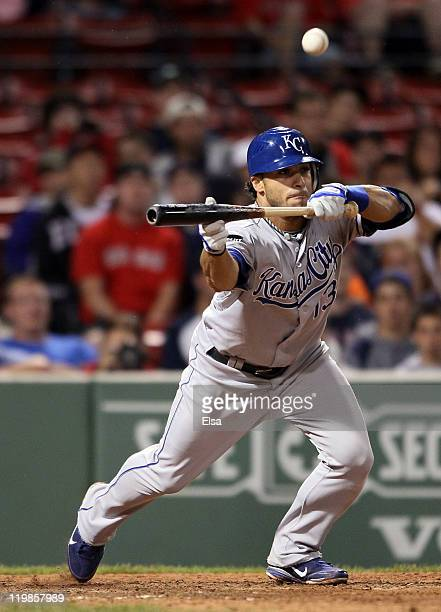Mike Aviles of the Kansas City Royals hits an RBI bunt in the 14th inning against the Boston Red Sox on July 26 2011 at Fenway Park in Boston...