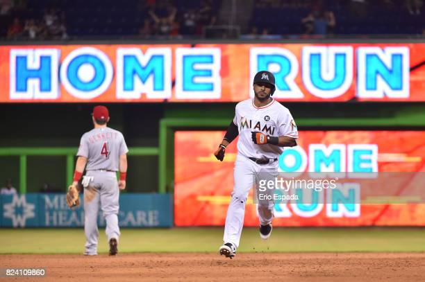 Mike Aviles of the Miami Marlins rounds second base after hitting a home run during the seventh inning against the Cincinnati Reds at Marlins Park on...