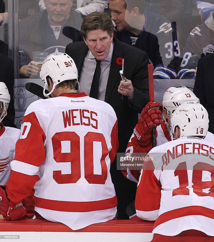 <a gi-track='captionPersonalityLinkClicked' href=/galleries/search?phrase=Mike+Babcock&family=editorial&specificpeople=226668 ng-click='$event.stopPropagation()'>Mike Babcock</a>, head coach of the Detroit Red Wings, talks to his players on the bench in first period action in an NHL game against the Winnipeg Jets at the MTS Centre on November 4, 2013 in Winnipeg, Manitoba, Canada.