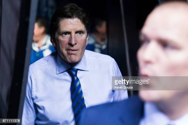 Mike Babcock head coach of the Toronto Maple Leafs heads to the bench for warmup prior to Game Four of the Eastern Conference First Round during the...