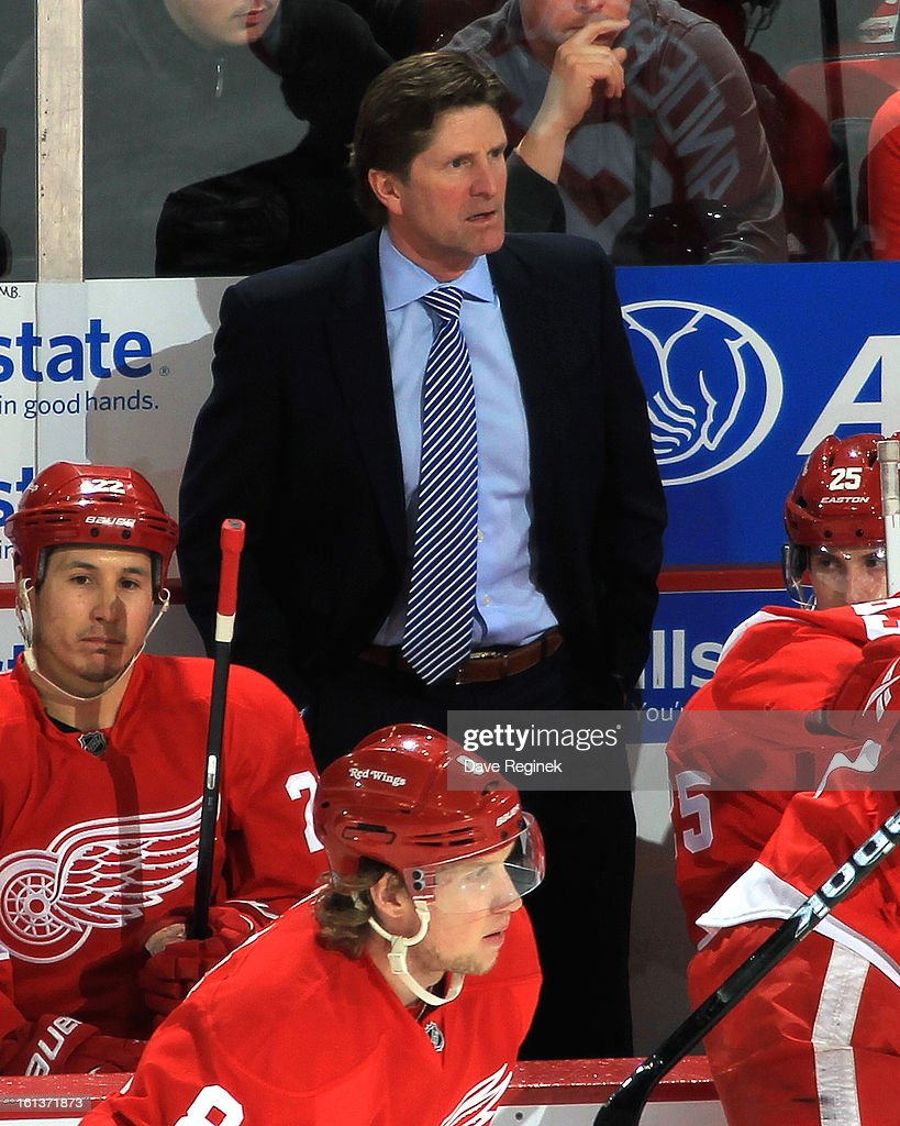 <a gi-track='captionPersonalityLinkClicked' href=/galleries/search?phrase=Mike+Babcock&family=editorial&specificpeople=226668 ng-click='$event.stopPropagation()'>Mike Babcock</a> of the Detroit Red Wings stands behind the bench for the 750th time as a NHL Head Coach during a game against the Los Angeles Kings at Joe Louis Arena on February 10, 2013 in Detroit, Michigan.