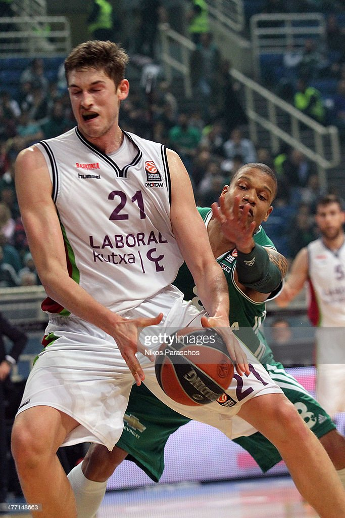 Mike Batiste #8 of Panathinaikos Athens competes with Tibor Pleiss #21 of Laboral Kutxa Vitoria during the 20132014 Turkish Airlines Euroleague Top...
