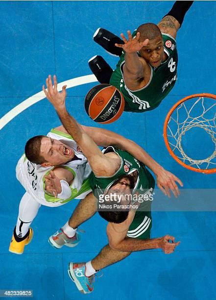 Mike Batiste #8 of Panathinaikos Athens competes with Vladimir Stimac #51 of Unicaja Malaga during the 20132014 Turkish Airlines Euroleague Top 16...