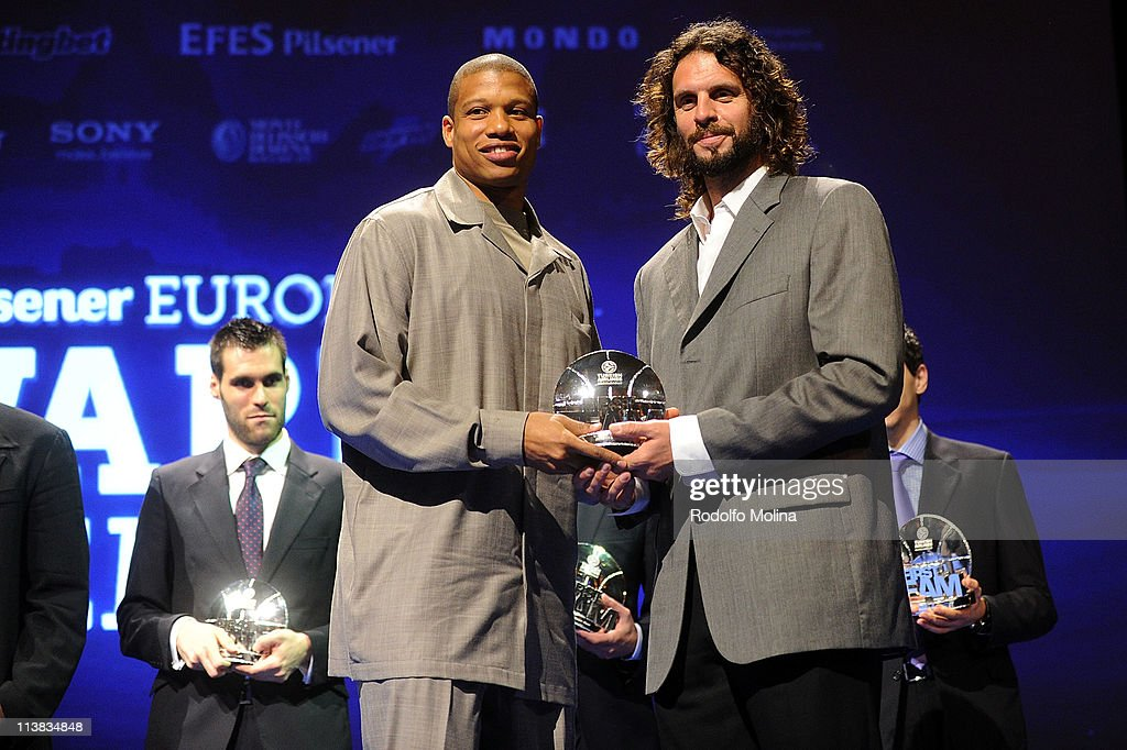 Mike Batiste #8 of Panathinaikos Athens receives from Fragiskos Alvertis former player the All Euroleague First Team trophy during the Season Awards...